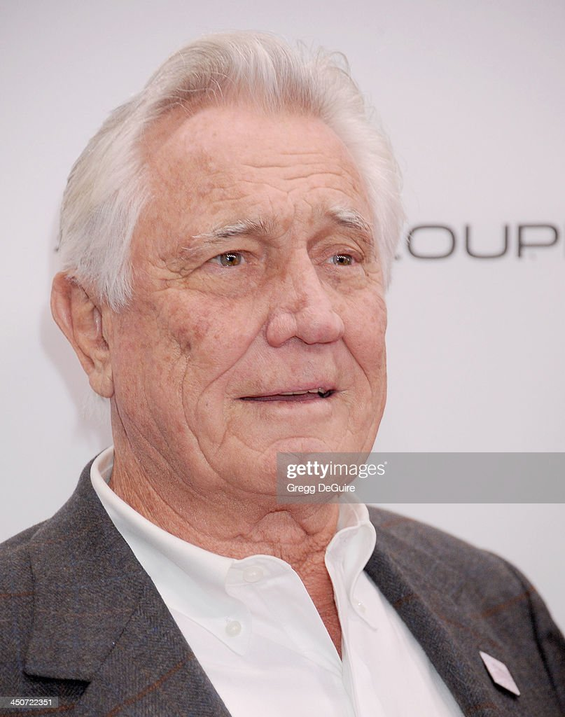 Actor George Lazenby arrives at the Jaguar F-TYPE Coupe launch party at Raleigh Studios on November 19, 2013 in Playa Vista, California.