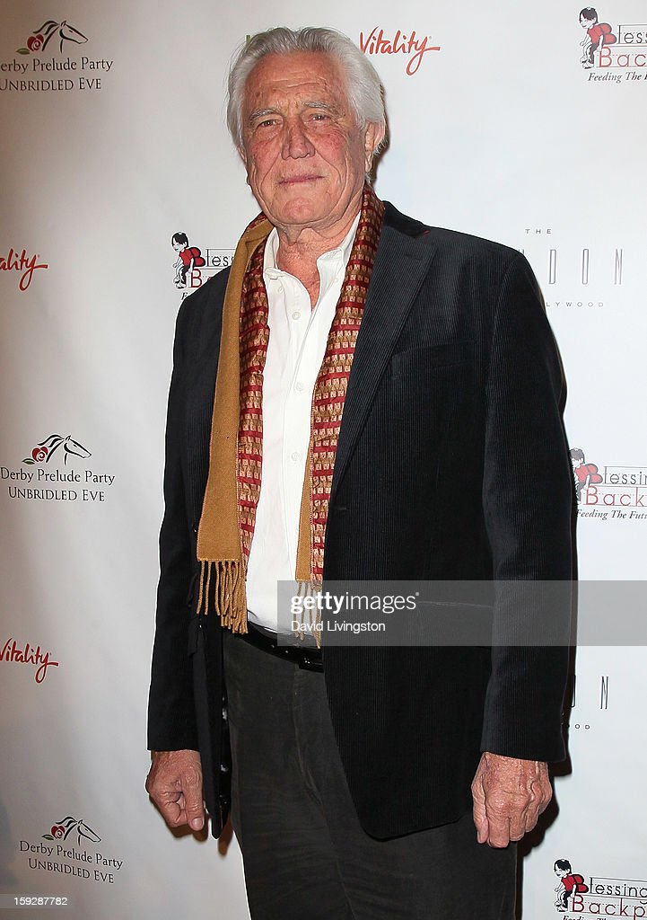 Actor <a gi-track='captionPersonalityLinkClicked' href=/galleries/search?phrase=George+Lazenby&family=editorial&specificpeople=228936 ng-click='$event.stopPropagation()'>George Lazenby</a> attends the Kentucky Derby Prelude Party at The London West Hollywood on January 10, 2013 in West Hollywood, California.