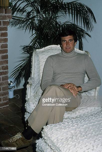 Actor George Lazenby poses for a portrait in 1984 in Los Angeles California