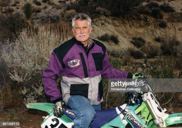 Actor George Lazenby who played James Bond in film poses for a portrait session wearing motorcycle gear in circa 1995 in Los Angeles California