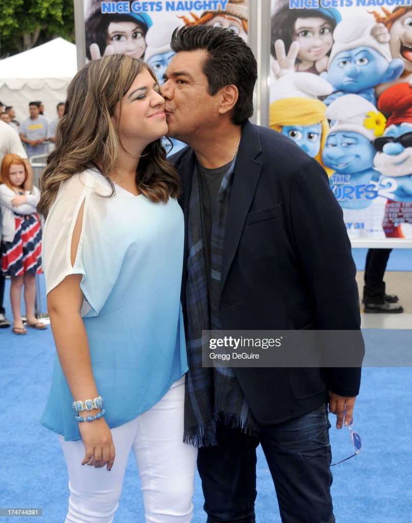Actor George Lopez and daughter Mayan Lopez arrive at the Los Angeles premiere of 'Smurfs 2' at Regency Village Theatre on July 28, 2013 in Westwood, California.