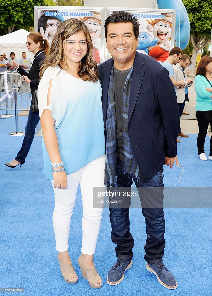 Actor George Lopez and daughter Mayan Lopez arrive at the Los Angeles Premiere 'Smurfs 2' at Regency Village Theatre on July 28, 2013 in Westwood, California.