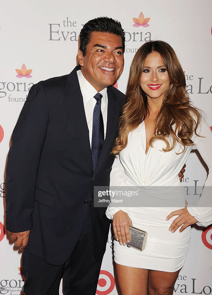Actor George Lopez and Jackie Guerrido arrive at the Eva Longoria Foundation Dinner at Beso restaurant on September 28, 2013 in Hollywood, California.