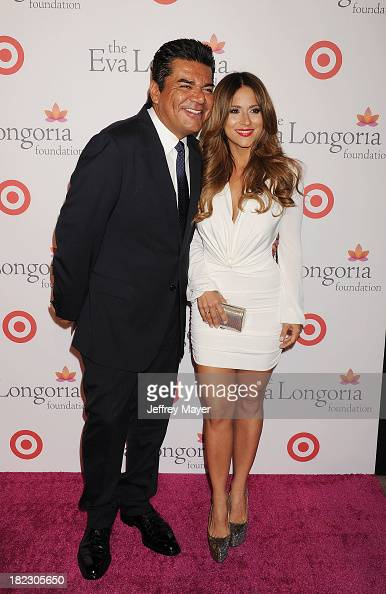 Actor George Lopez and Jackie Guerrido arrive at the Eva Longoria Foundation Dinner at Beso restaurant on September 28 2013 in Hollywood California
