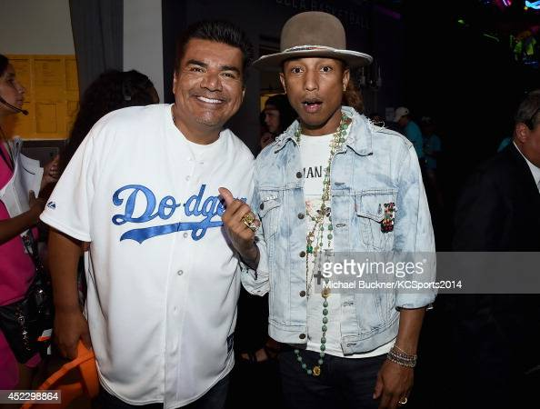 Actor George Lopez with Pharrell Williams backstage at the Nickelodeon Kids' Choice Sports Awards 2014 at UCLA's Pauley Pavilion on July 17 2014 in...
