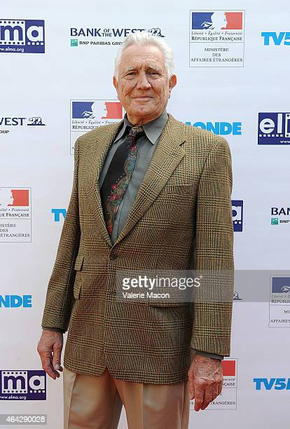 Actor George Robert Lazenby attends The Consul General Of France Mr Axel Cruau Honors The French Nominees For The 87th Annual Academy Awards at...