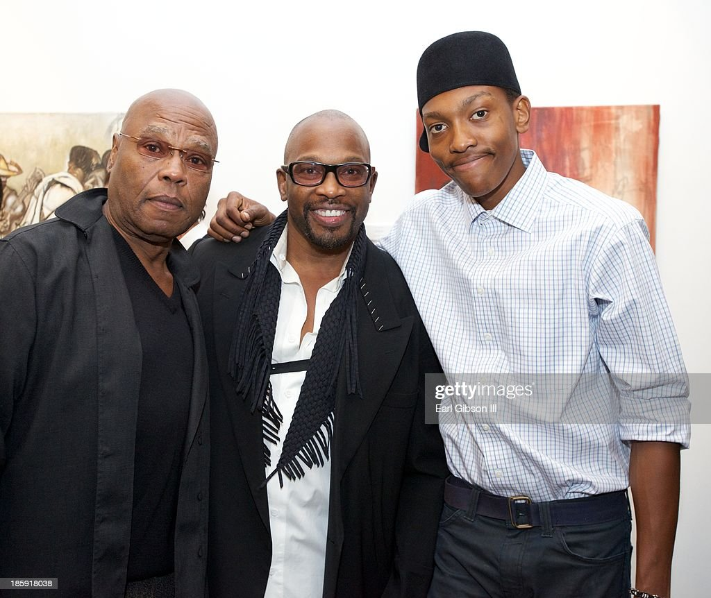 Actor George Stanford, Artist Chaz Guest and Zuhri Guest pose for a photo at the 'Visions Of Mexico' Artist Retrospective at Quinn Studios on October 25, 2013 in Santa Monica, California.