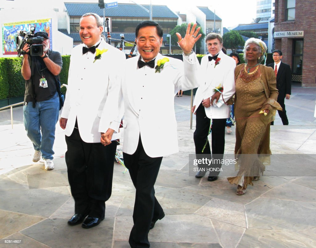 Actor <a gi-track='captionPersonalityLinkClicked' href=/galleries/search?phrase=George+Takei&family=editorial&specificpeople=1534988 ng-click='$event.stopPropagation()'>George Takei</a> (2nd L) (the 'Sulu' charactor on 'Star Trek') and partner Brad Altman (L) after they were married at the Japanese American National Museum on September 14, 2008 in Los Angeles. Fellow 'Star Trek' actors Walter Koenig (2nd R) and Nichelle Nichols (R) who participated in the ceremony follow. AFP PHOTO/Stan HONDA