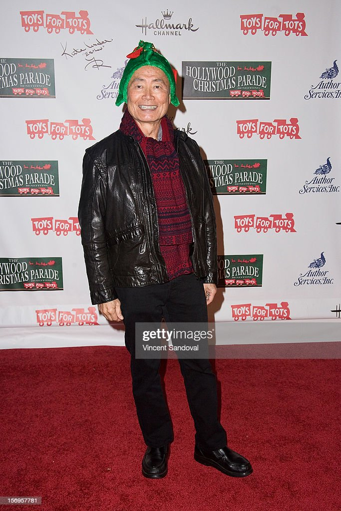 Actor <a gi-track='captionPersonalityLinkClicked' href=/galleries/search?phrase=George+Takei&family=editorial&specificpeople=1534988 ng-click='$event.stopPropagation()'>George Takei</a> attends the 2012 Hollywood Christmas Parade Benefiting Marine Toys For Tots on November 25, 2012 in Los Angeles, California.