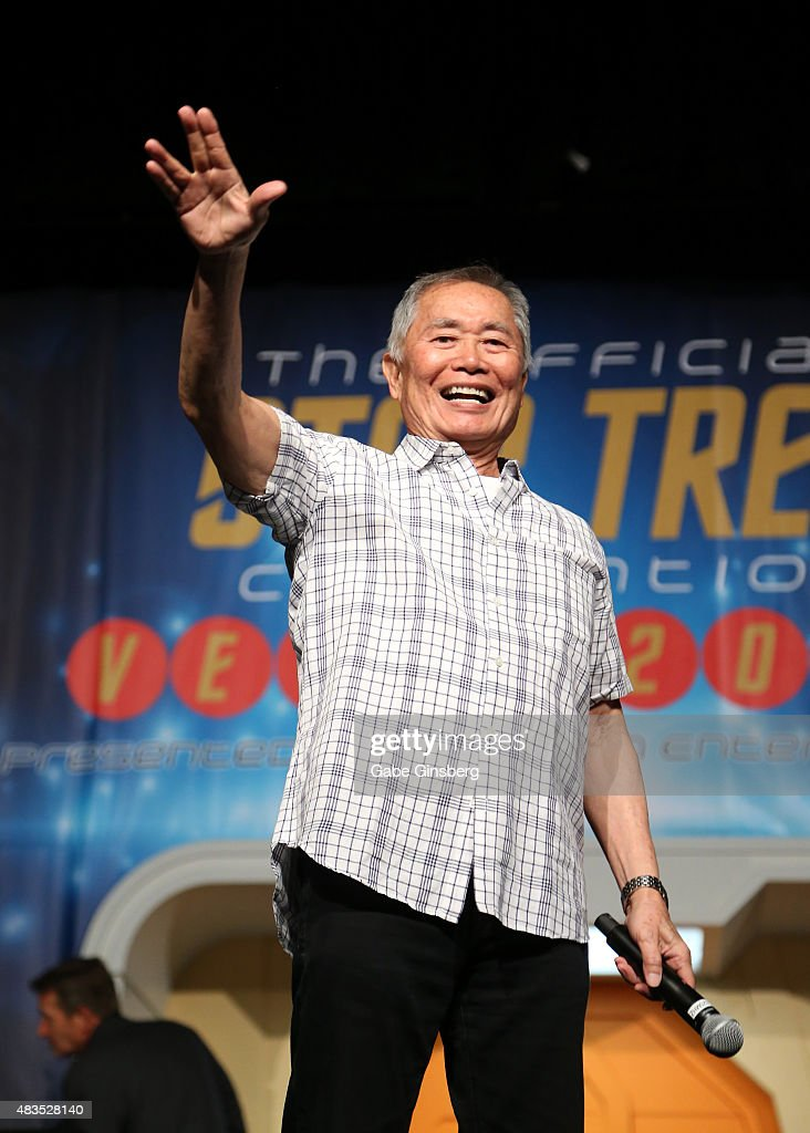 Actor George Takei extends his arm with a 'live long and prosper' gesture from the 'Star Trek' television franchise as he speaks during the 14th annual official Star Trek convention at the Rio Hotel & Casino on August 9, 2015 in Las Vegas, Nevada.