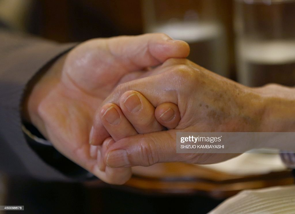 US actor George Takei (R) holds hands with his husband Brad Altman before a reception of LGBT community at the US Ambassador to Japan Caroline Kennedy's official residence in Tokyo on June 5, 2014. Takei, The 'Star Trek' actor, said he needed courage and anger to come out as gay and to join the equal rights movement for sexual minorities in the US, and he hopes his Japanese counterparts will do the same to make their society more equal.