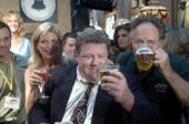 Actor George Wendt known as Norm on the sitcom 'Cheers' looks at his beer August 23 2001 on opening night at the 'Cheers' bar in Boston MA Drinking...