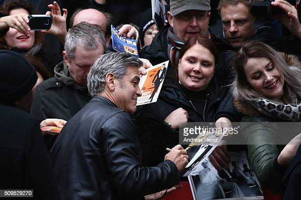 Actor Georges Clooney signs autograph prior the 'Hail Caesar' photo call during the 66th Berlinale International Film Festival Berlin at Grand Hyatt...