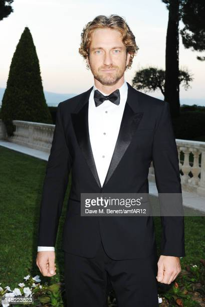 Actor Gerald Butler attends the 2012 amfAR's Cinema Against AIDS during the 65th Annual Cannes Film Festival at Hotel Du Cap on May 24 2012 in Cap...