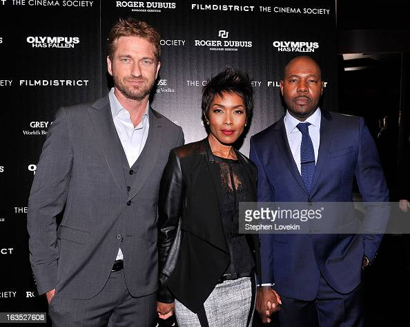 Actor Gerard Butler actress Angela Bassett and director Antoine Fuqua attend The Cinema Society with Roger Dubuis and Grey Goose screening of...