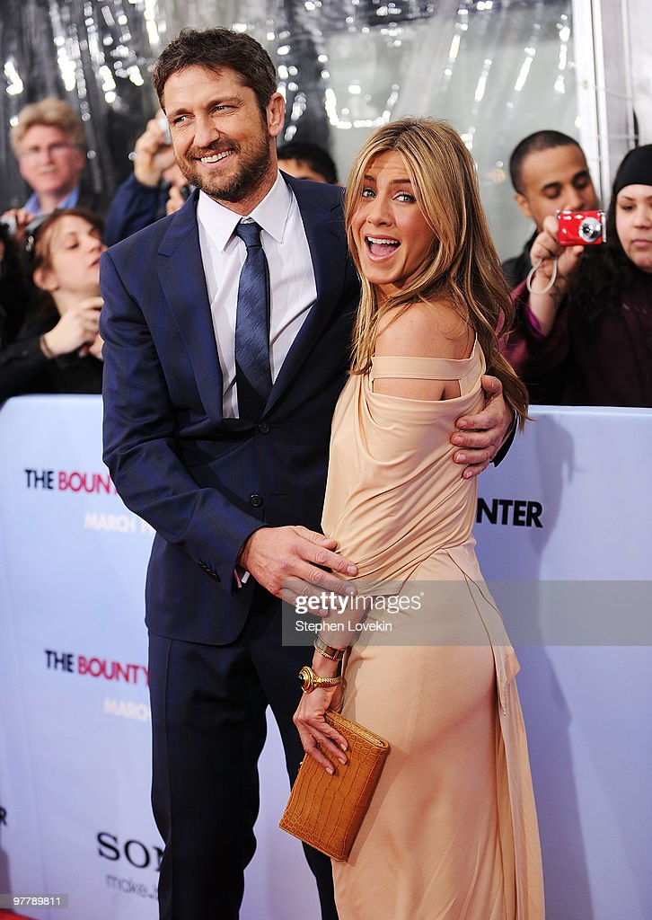 Actor <a gi-track='captionPersonalityLinkClicked' href=/galleries/search?phrase=Gerard+Butler+-+Actor&family=editorial&specificpeople=202258 ng-click='$event.stopPropagation()'>Gerard Butler</a> (L) and actress <a gi-track='captionPersonalityLinkClicked' href=/galleries/search?phrase=Jennifer+Aniston&family=editorial&specificpeople=202048 ng-click='$event.stopPropagation()'>Jennifer Aniston</a> attend the premiere of 'The Bounty Hunter' at Ziegfeld Theatre on March 16, 2010 in New York, New York City.