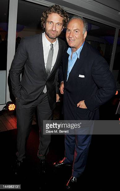 Actor Gerard Butler and Charles Finch attend the IWC and Finch's Quarterly Review Annual Filmmakers Dinner at Hotel Du CapEden Roc on May 21 2012 in...