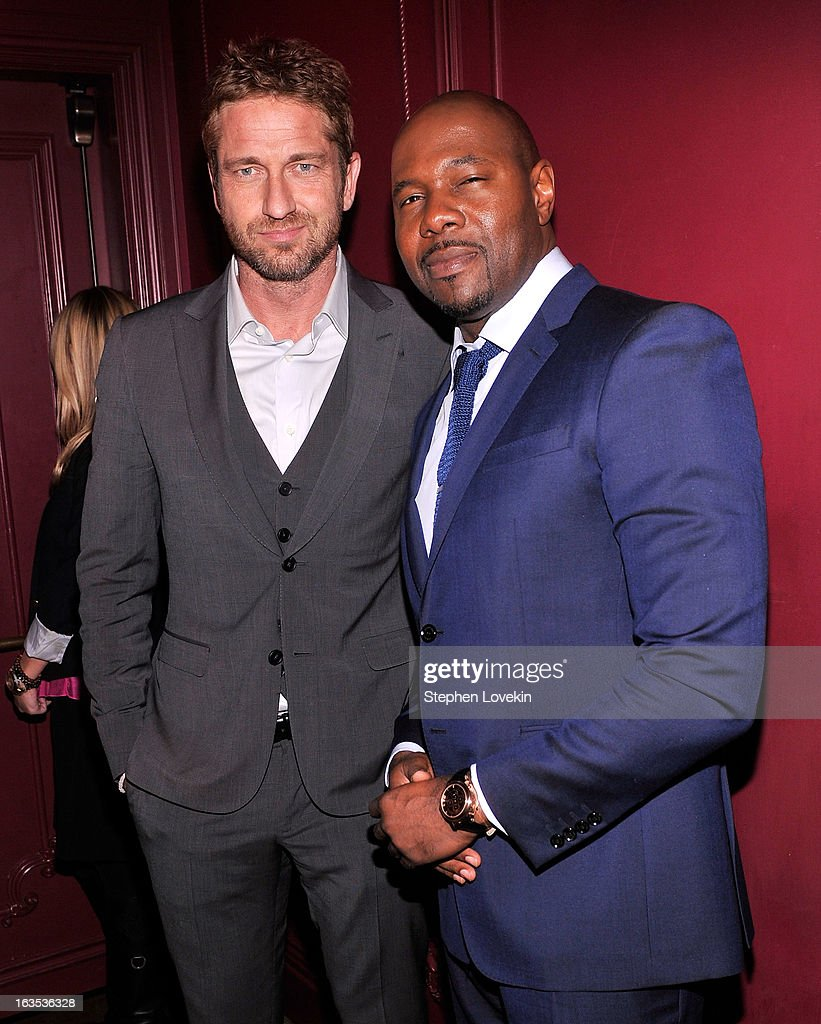 Actor <a gi-track='captionPersonalityLinkClicked' href=/galleries/search?phrase=Gerard+Butler+-+Actor&family=editorial&specificpeople=202258 ng-click='$event.stopPropagation()'>Gerard Butler</a> and director <a gi-track='captionPersonalityLinkClicked' href=/galleries/search?phrase=Antoine+Fuqua&family=editorial&specificpeople=2480782 ng-click='$event.stopPropagation()'>Antoine Fuqua</a> attend the after party for The Cinema Society with Roger Dubuis and Grey Goose screening of FilmDistrict's 'Olympus Has Fallen' at The Darby on March 11, 2013 in New York City.