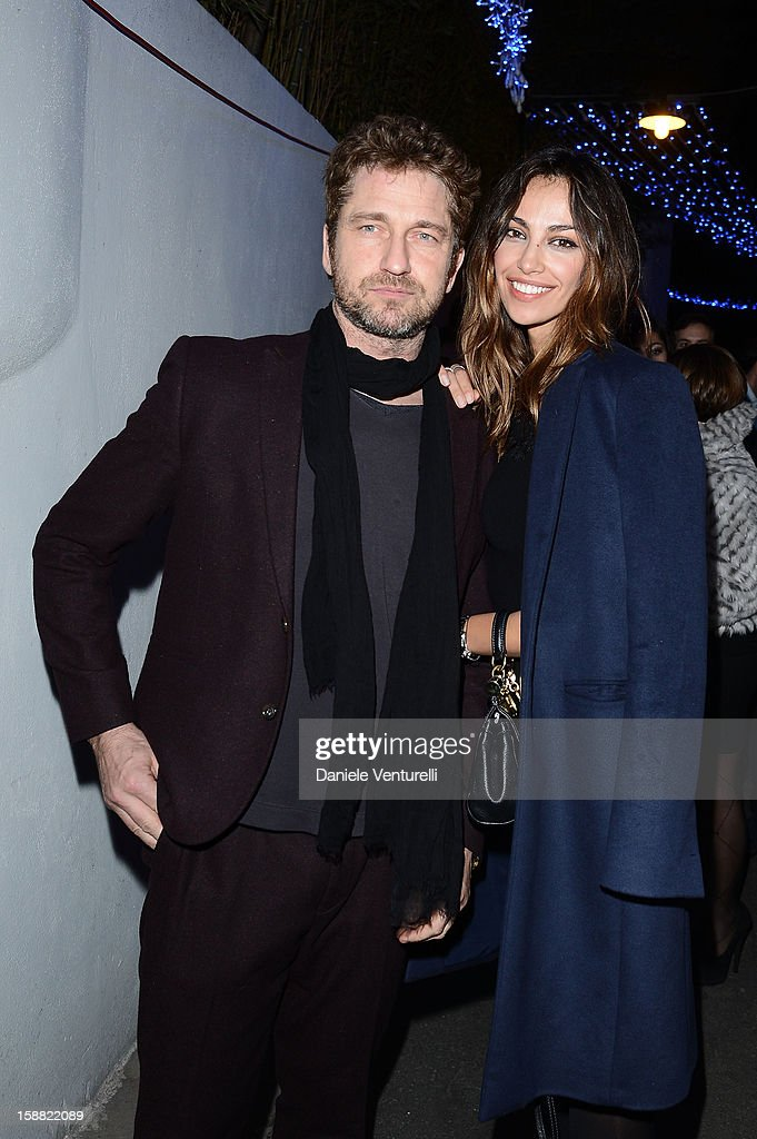 Actor Gerard Butler and Madalina Ghenea attends Day 5 of the 2012 Capri Hollywood Film Festival on December 30, 2012 in Capri, Italy.