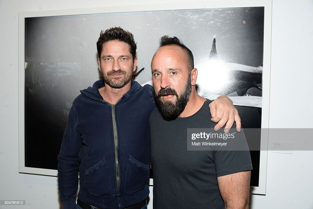 Actor Gerard Butler and photographer Michael Muller attend the Opening Reception for Michael Muller's book 'Shark' hosted by TASCHEN at TASCHEN...