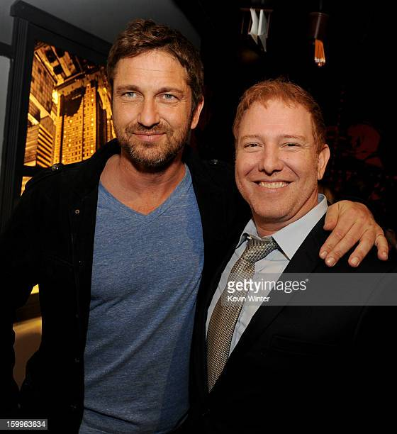 Actor Gerard Butler and Ryan Kavanaugh CEO Relativity Media pose at the after party for the premiere of Relativity Media's 'Movie 43' at Madame...