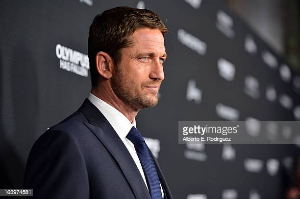 Actor Gerard Butler arrives at the premiere of FilmDistrict's 'Olympus Has Fallen' at ArcLight Cinemas Cinerama Dome on March 18 2013 in Hollywood...