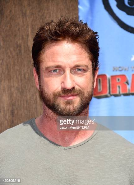 Actor Gerard Butler arrives at the LA premiere of 'How To Train Your Dragon 2' at the Regency Village Theatre on June 8 2014 in Westwood California