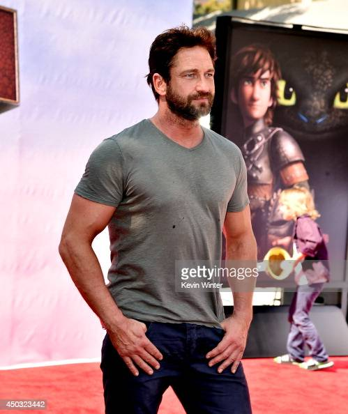 Actor Gerard Butler arrives at the premiere of Twentieth Century Fox and DreamWorks Animation 'How To Train Your Dragon 2' at the Village Theatre on...