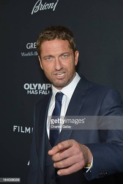 Actor Gerard Butler attends Brioni Sponsors Film District's World Premiere Of 'Olympus Has Fallen' ArcLight Cinemas on March 18 2013 in Hollywood...