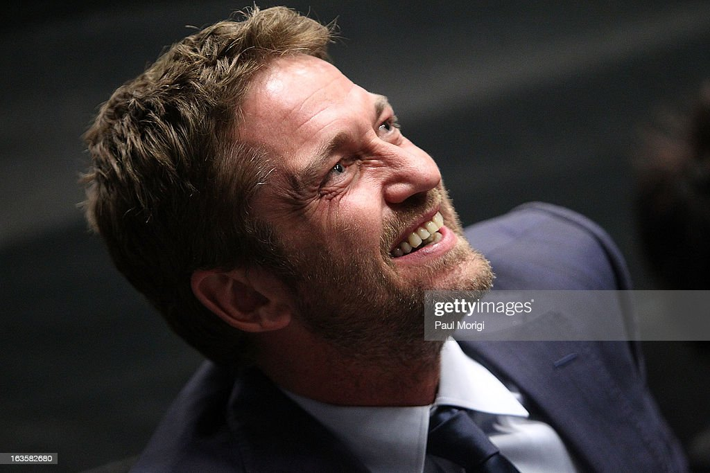 Actor Gerard Butler attends the 'Olympus Has Fallen' screening Q & A at AMC Loews Georgetown 14 on March 12, 2013 in Washington, DC.