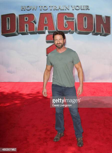 Actor Gerard Butler attends the premiere of Twentieth Century Fox and DreamWorks Animation 'How to Train Your Dragon 2' at the Regency Village...