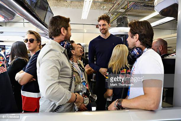 Actor Gerard Butler meets San Antonio Spurs basketball player Pau Gasol in the Red Bull Racing garage during qualifying for the United States Formula...