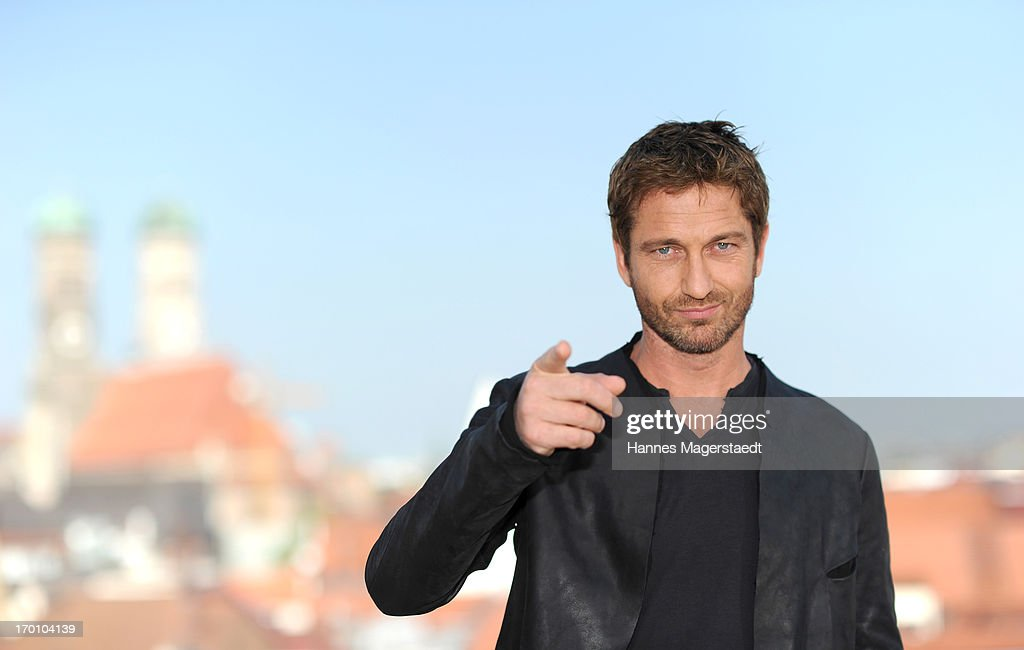 Actor <a gi-track='captionPersonalityLinkClicked' href=/galleries/search?phrase=Gerard+Butler+-+Actor&family=editorial&specificpeople=202258 ng-click='$event.stopPropagation()'>Gerard Butler</a> poses during the 'Olympus Has Fallen - Die Welt in Gefahr' photocall at Hotel Mandarin Oriental on June 7, 2013 in Munich, Germany.