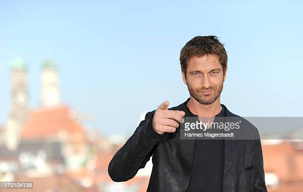 Actor Gerard Butler poses during the 'Olympus Has Fallen Die Welt in Gefahr' photocall at Hotel Mandarin Oriental on June 7 2013 in Munich Germany