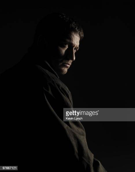 Actor Gerard Butler poses for a portrait session for press for the film 'Law Abiding Citizen' in Philadelphia