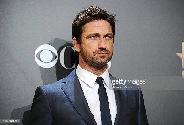 Actor Gerard Butler poses in the press room at the 18th annual Hollywood Film Awards at Hollywood Palladium on November 14 2014 in Hollywood...