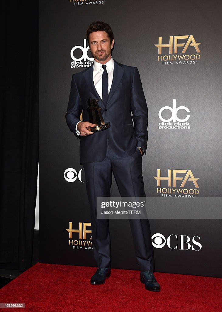Actor <a gi-track='captionPersonalityLinkClicked' href=/galleries/search?phrase=Gerard+Butler&family=editorial&specificpeople=202258 ng-click='$event.stopPropagation()'>Gerard Butler</a> poses in the press room during the 18th Annual Hollywood Film Awards at The Palladium on November 14, 2014 in Hollywood, California.