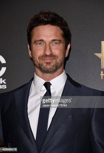Actor Gerard Butler winner of Hollywood Animation Award for 'How to Train Your Dragon 2' poses in the press room during the 18th Annual Hollywood...