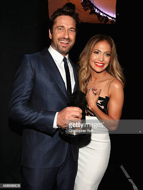 Actor Gerard Butler winner of the Hollywood Animation Award for 'How to Train Your Dragon 2' and actress/singer Jennifer Lopez attend the 18th Annual...