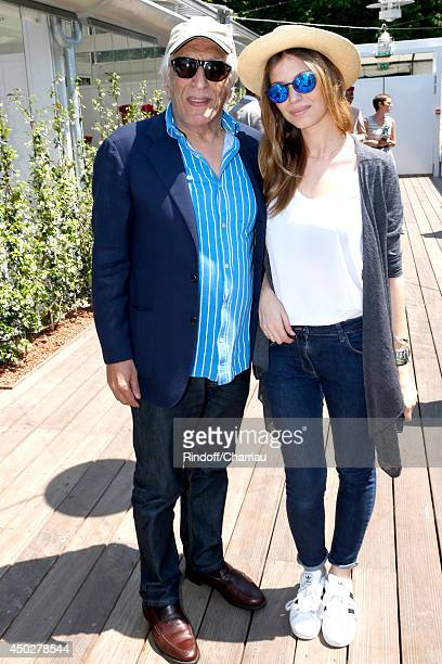 Actor Gerard Darmon and his companion attend the Men's Final of Roland Garros French Tennis Open 2014 Day 15 on June 8 2014 in Paris France