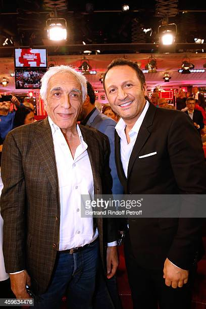Actor Gerard Darmon and TV Host Arthur attend the 'Vivement Dimanche' French TV Show at Pavillon Gabriel on November 26 2014 in Paris France