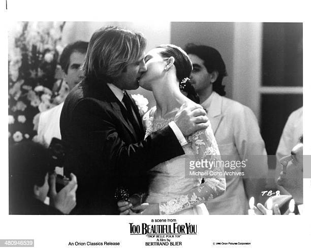 Actor Gerard Depardieu and actress Carole Bouquet in a scene from the Orion Classic movie ' Too Beautiful for You' circa 1989