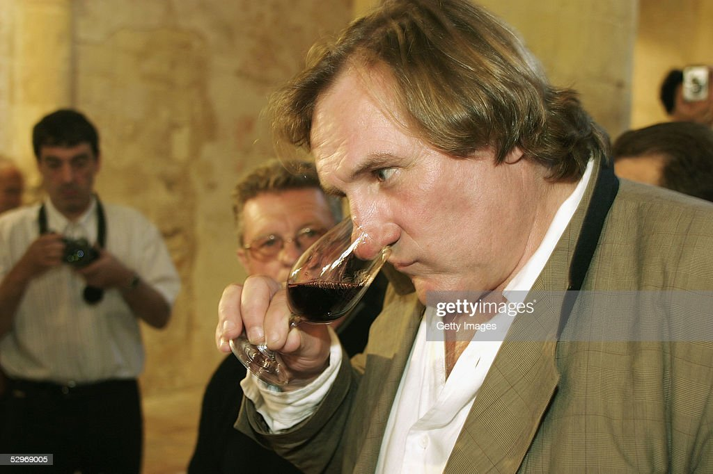 Actor <a gi-track='captionPersonalityLinkClicked' href=/galleries/search?phrase=Gerard+Depardieu&family=editorial&specificpeople=207073 ng-click='$event.stopPropagation()'>Gerard Depardieu</a> (along with his partner Bernard Magrez) presents his new 2004 vin de garage vintage wine called 'Le bien decide' at his 3 hectare vineyard 'Coteaux du Languedoc' in Aniane, near Montpellier, on May 23, 2005 in Aniane, France.