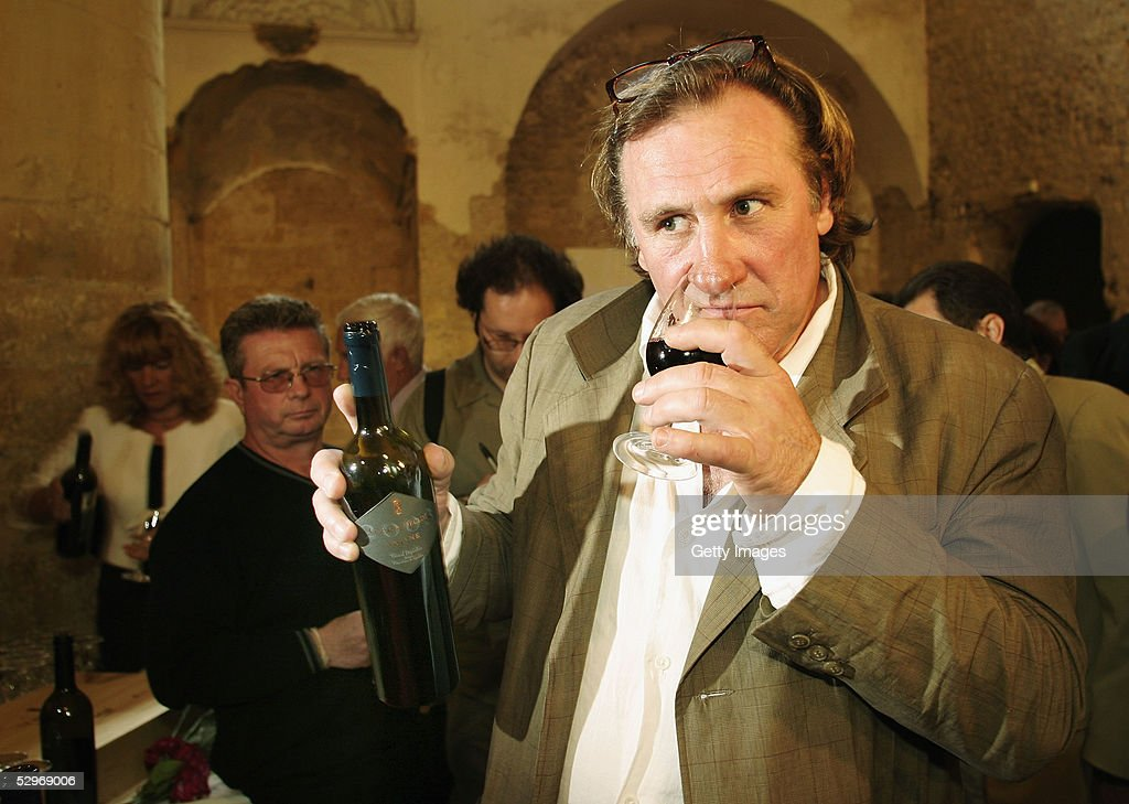 Actor Gerard Depardieu (along with his partner Bernard Magrez) presents his new 2004 vin de garage vintage wine called 'Le bien decide' at his 3 hectare vineyard 'Coteaux du Languedoc' in Aniane, near Montpellier, on May 23, 2005 in Aniane, France.
