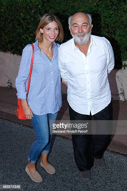 Actor Gerard Jugnot and his companion Patricia Campi attend the 'La colere du Tigre' Theater play during the 31th Ramatuelle Festival Day 6 on August...