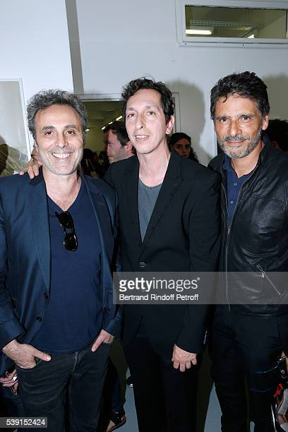 Actor Gilbert Melki Model of the Exhibition director Stephane Foenkinos and actor Pascal Elbe attend the '55 Politiques' Exhibition of Stephanie...