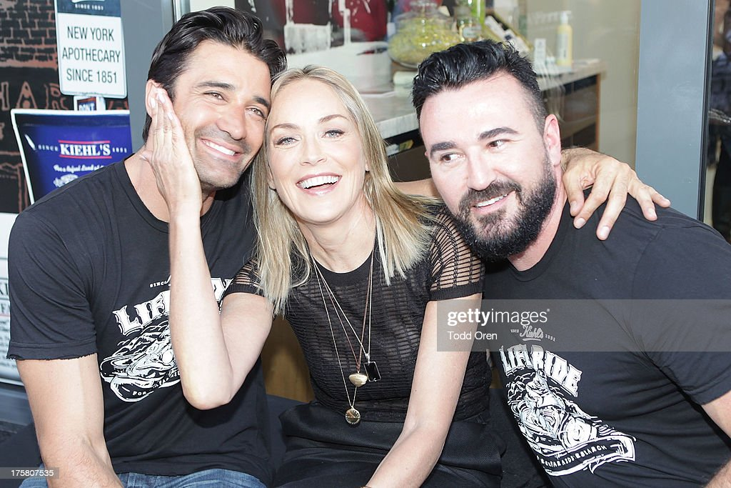 Actor Giles Marini, actress <a gi-track='captionPersonalityLinkClicked' href=/galleries/search?phrase=Sharon+Stone&family=editorial&specificpeople=156409 ng-click='$event.stopPropagation()'>Sharon Stone</a> and President of Kiehl's <a gi-track='captionPersonalityLinkClicked' href=/galleries/search?phrase=Chris+Salgardo&family=editorial&specificpeople=5384803 ng-click='$event.stopPropagation()'>Chris Salgardo</a> rides at the Kiehl's Since 1851 Liferide for amfAR at The Grove on August 8, 2013 in Los Angeles, California.