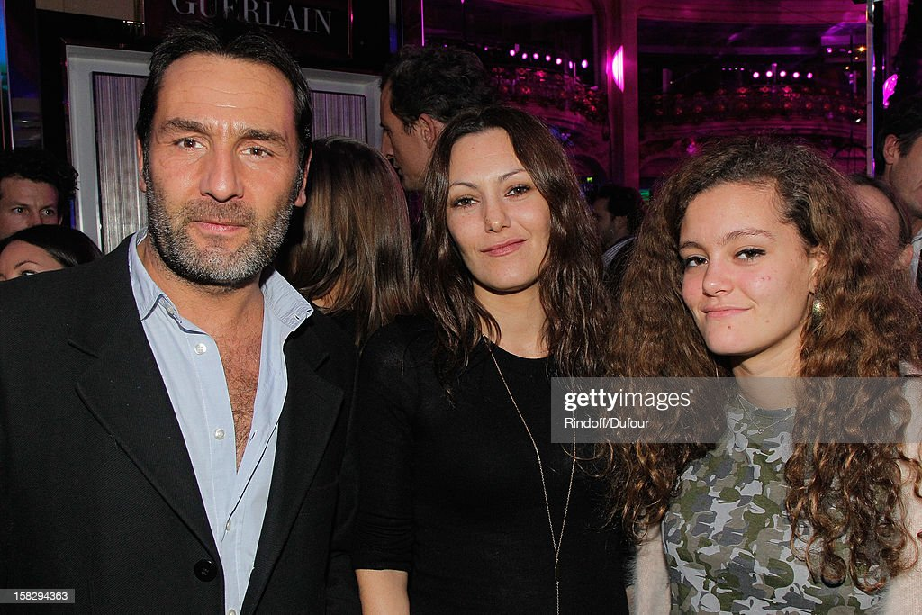Actor <a gi-track='captionPersonalityLinkClicked' href=/galleries/search?phrase=Gilles+Lellouche&family=editorial&specificpeople=626596 ng-click='$event.stopPropagation()'>Gilles Lellouche</a>, actress Karole Rocher and her daughter attend the Galeries Lafayette 100th Anniversary Bal on December 12, 2012 in Paris, France.