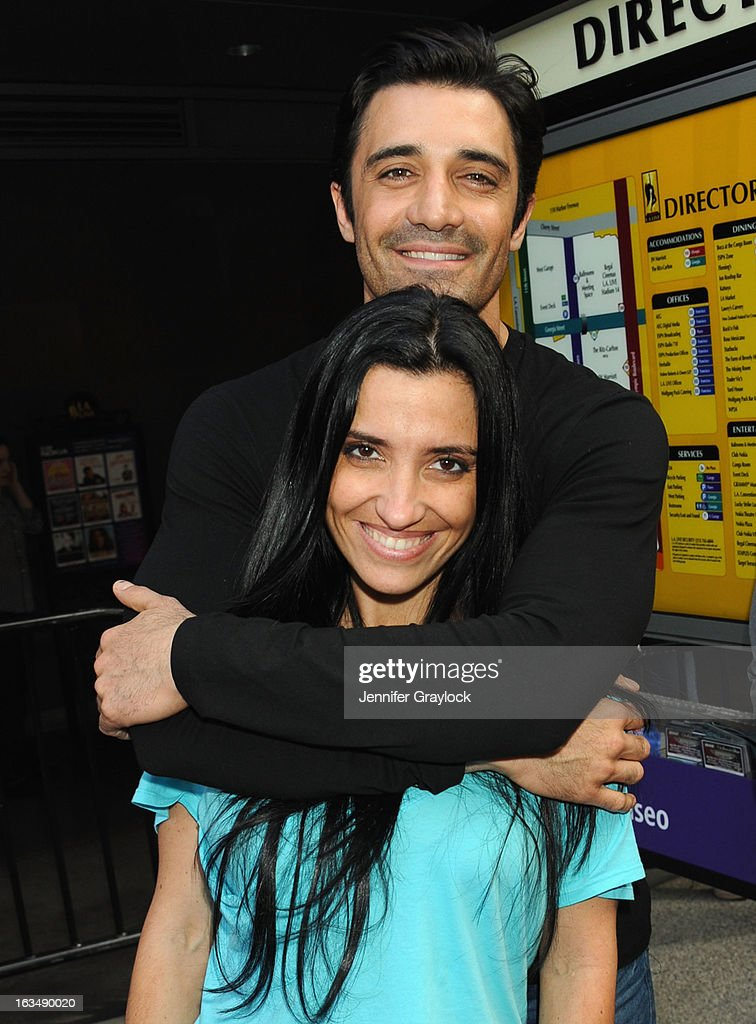 Actor <a gi-track='captionPersonalityLinkClicked' href=/galleries/search?phrase=Gilles+Marini&family=editorial&specificpeople=5360860 ng-click='$event.stopPropagation()'>Gilles Marini</a> and wife <a gi-track='captionPersonalityLinkClicked' href=/galleries/search?phrase=Carole+Marini&family=editorial&specificpeople=5722127 ng-click='$event.stopPropagation()'>Carole Marini</a> attend the Lakers Casino Night held at Club Nokia on March 10, 2013 in Los Angeles, California.