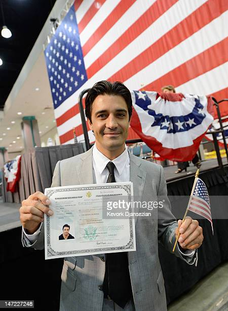 Actor Gilles Marini from France holds up his US citizenship certificate after taking the oath of citizenship at a naturalization ceremony at the Los...